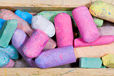 used colored chalks in wood box