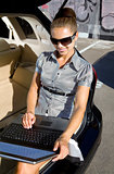 businesswoman has a fan with laptop