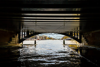 View from under bridge to Amsterdam  in the late autumn, Amstel