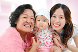 Happy Asian family at home