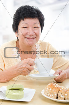 Asian senior woman having breakfast