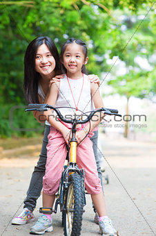 Asian family riding bike