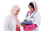Two Southeast Asian Muslim medical doctors discussing
