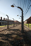Silhouetted lamp and barbed wire, Auschwitz