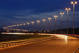 Mast lighting, night freeway, illumination on the road.