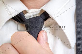 Correcting black tie