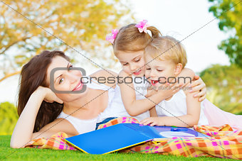 Mother with two kids outdoors
