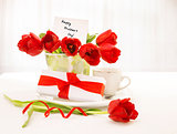 Tulips bouquet and coffee cup