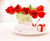Red tulips and cup of tea