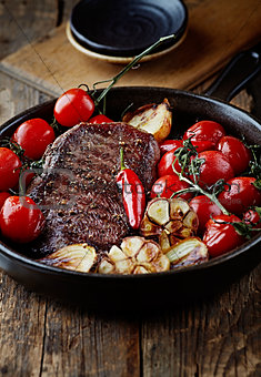 Grilled beef steak with rustic vegetables