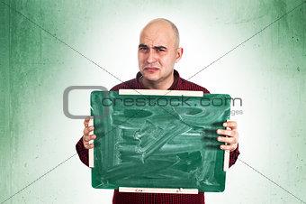 Sad man with chalkboard
