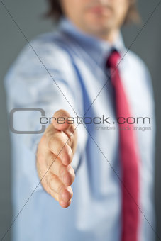 Shake hands with businessman