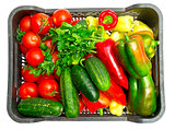 Fresh vegetables in a box on a white background