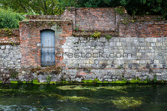 Old stone wall on river