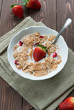 Breakfast cereals with milk and strawberries