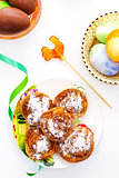 Easter eggs with plate of sweet rolls