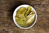 bay leaves in ceramic bowl