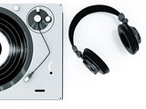 headphones and turntable on a white background