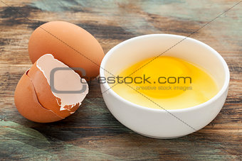 broken egg in a bowl