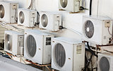 Many older air conditioners on the wall