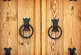 Handles on the old-fashioned wooden door