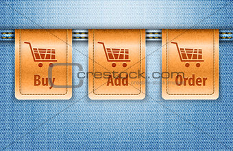 Blue jeans background with brown leather shopping labels