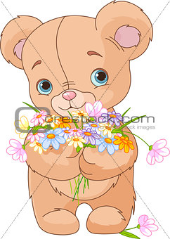 Teddy bear giving bouquet