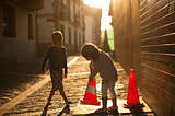 children playing with Two Traffic Cones
