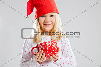 Smiling young girl holding big red cup