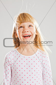 Happy young girl looking up