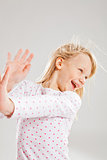 Happy smiling young girl with raised hands