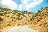 Road in mountain range at Olympos Mountains, Greece