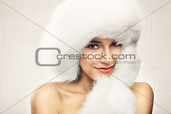 Fashion portrait of young beautiful woman posing on white backgr
