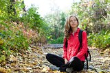 Happy young backpacker enjoying relaxation in the autumn nature