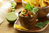 guakomole and corn chips - avocado and tomato dip
