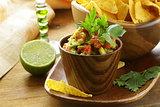 guakomole and corn chips - avocado and tomato dip