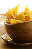 corn tortilla chips in a wooden bowl