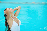 Young woman relaxing at poolside
