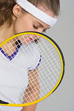 Closeup on frustrated tennis player