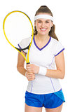 Portrait of smiling tennis player with racket