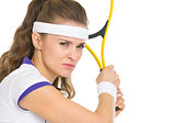 Confident tennis player ready to hit ball
