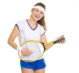 Smiling tennis player playing on racket as on guitar