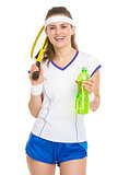 Happy tennis player with racket and water bottle