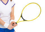 Closeup on tennis player holding tennis racket