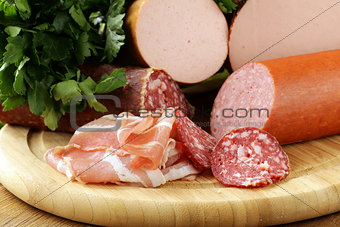 Assorted variety of sausages on a cutting board