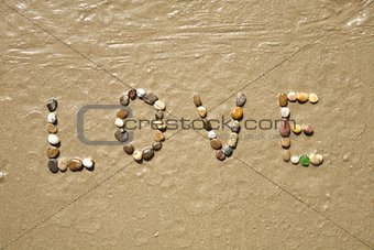 Love stones on sand beach