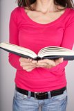 pink sweater woman reading