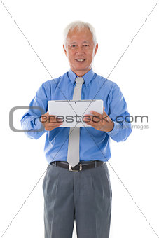 chinese senior business male with tablet