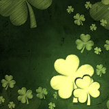 white striped shamrocks in green old paper background