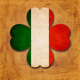 Irish flag in shamrock old paper background
